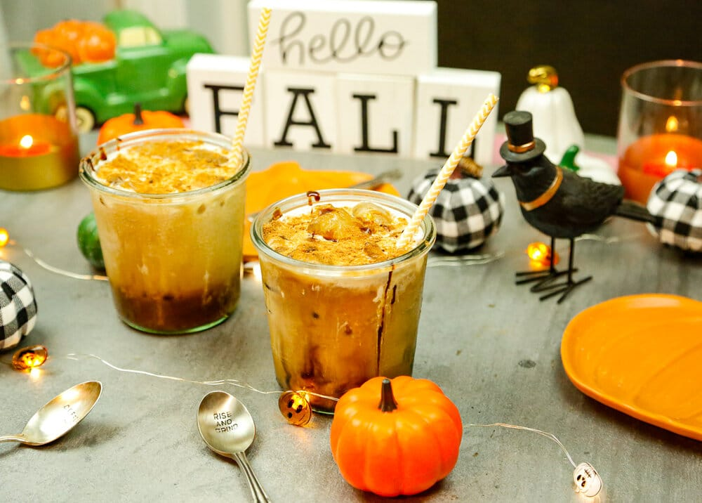 Iced pumpkin coffee in glasses with stainless steel straws n