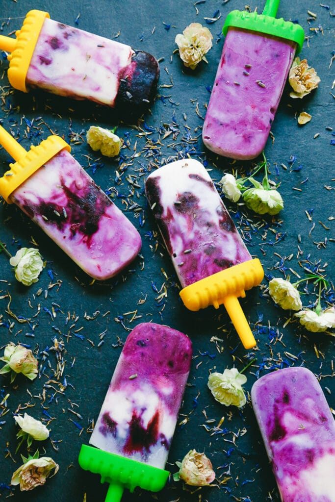 blueberry lavender popsicles that are dairy free and made with gorgeous fruit purple layers and coconut milk