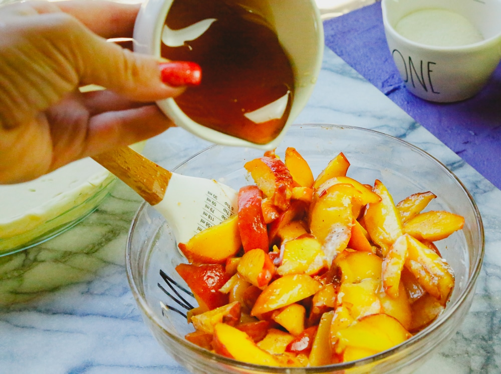 bowl of fresh peaches made with honey drizzled on top