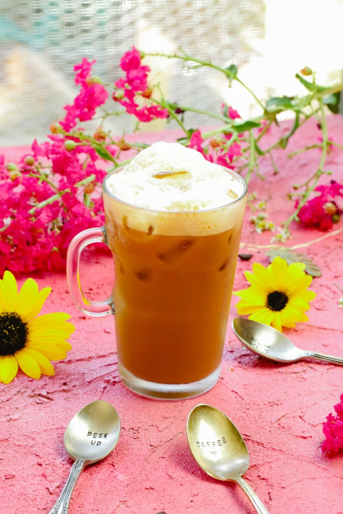 Iced coffee recipe shakerato in a glass made with condensed milk and shaken espresso
