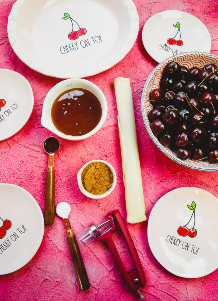 ingredients for homemade refined sugar free cherry pie and a cherry pie plate with measuring spoons