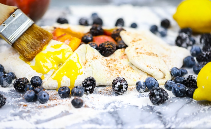 dough folded up into triangles along with fruit